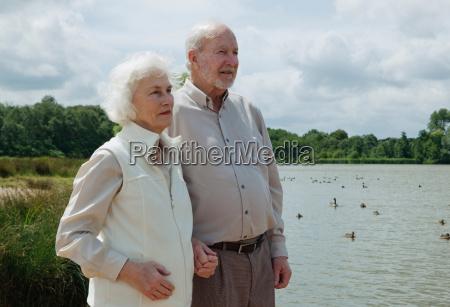 elderly man holding elderly womans hand