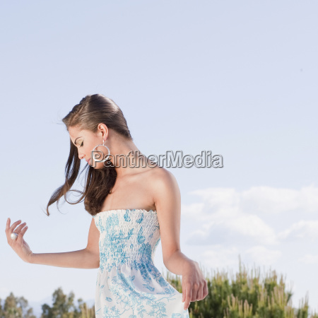 beautiful young woman in flowery dress