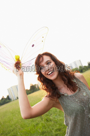 woman holding toy butterfly close up