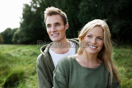 young couple standing in nature