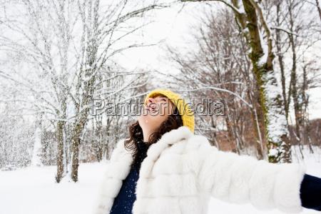 woman dancing in snowy woods