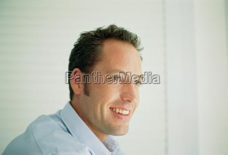 nærbillede, af, smilende, mands, ansigt - 18460372