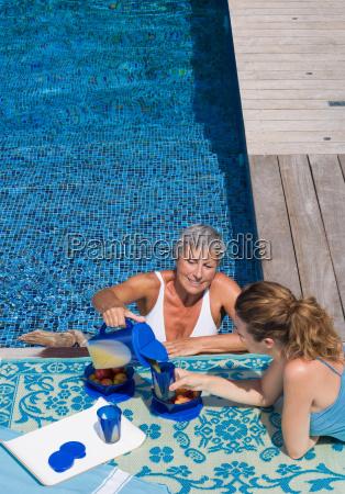 woman in swimming pool talking to