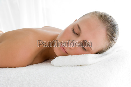 young woman lying on front