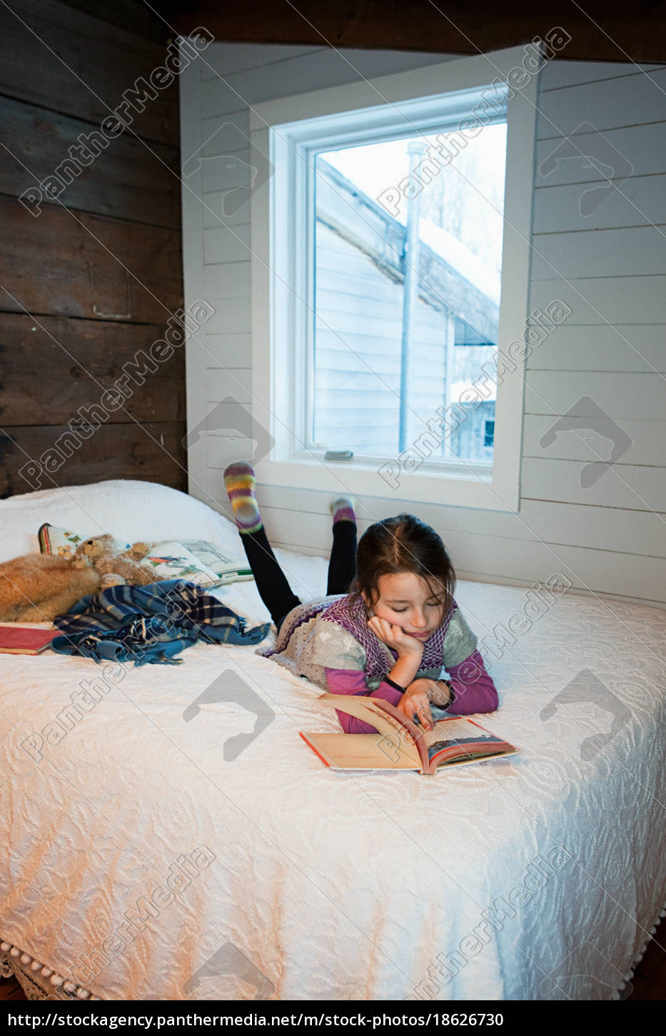 young, girl, lying, on, bed, reading - 18626730