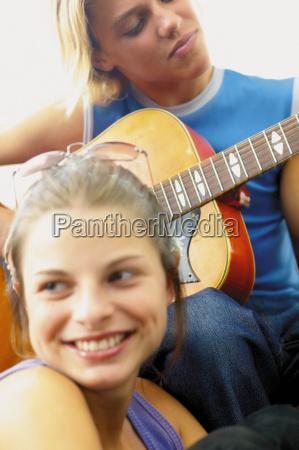 teenage boy and girl playing the