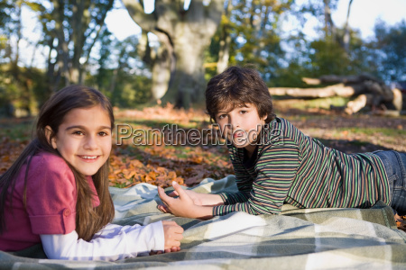 brother and sister in park