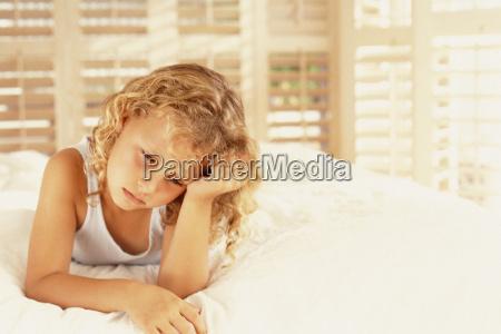 girl sulking on bed