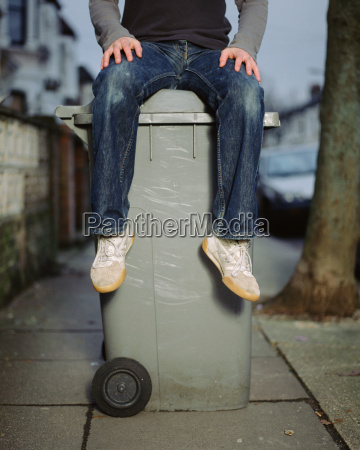 a young man sitting on a