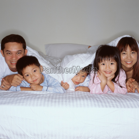 happy young family in bed