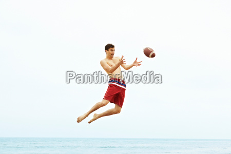 young man catching ball