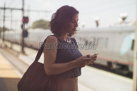 mid adult woman waiting at train