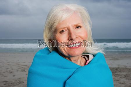 senior adult woman on the beach