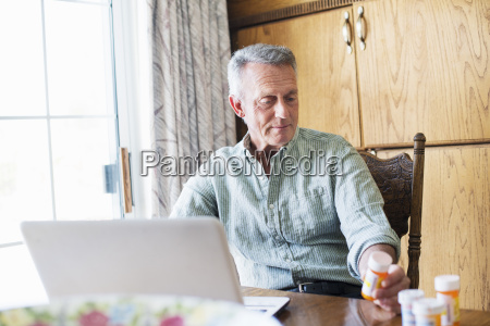 senior man sitting at a table