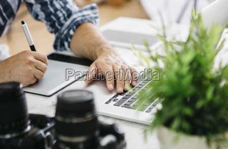 photographer working at desk with graphics