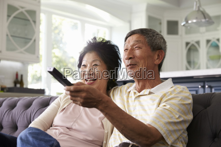 senior asian couple at home on