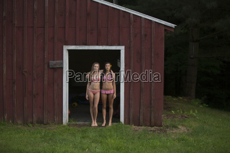 friends posing by wood cabin