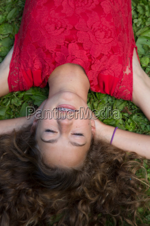 close up of teenage girl lying