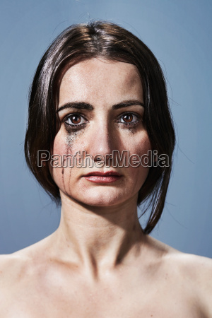 woman crying with makeup smudges on