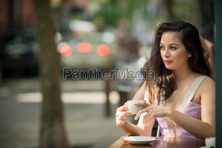 mid adult women drinking coffee in