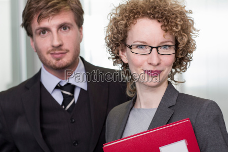 portrait of businesswoman and male colleague