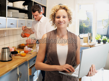 mid adult woman using laptop in