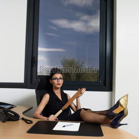businesswoman holder en cricket bat