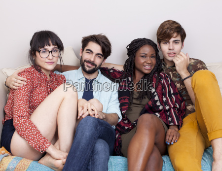 portrait of four young adult hipsters