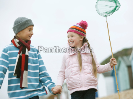 young boy and girl strolling along