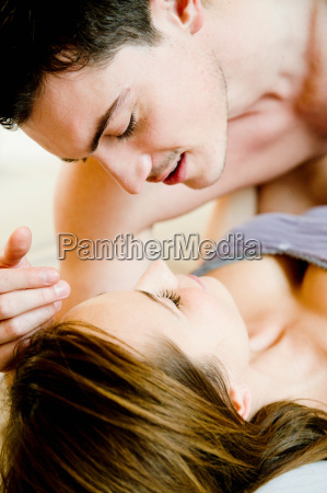 young couple lying on bed