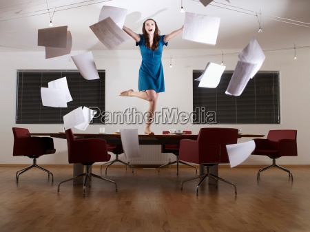 young woman dancing on conference table