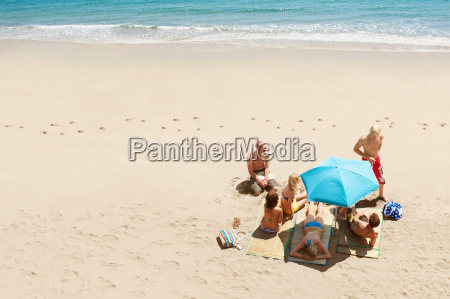 group, of, people, sunbathing, on, beach - 19510130