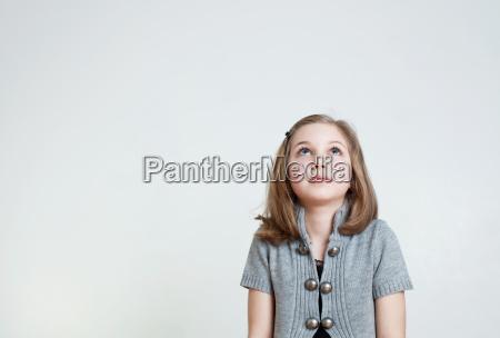 young girl looking up studio shot