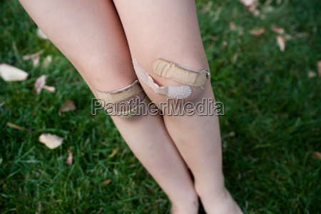 young girl with adhesive plasters on