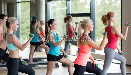group of women with dumbbells and