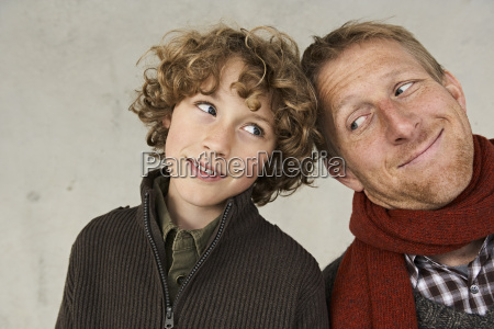 happy father and son leaning against