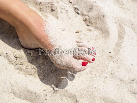 womans foot in the sand