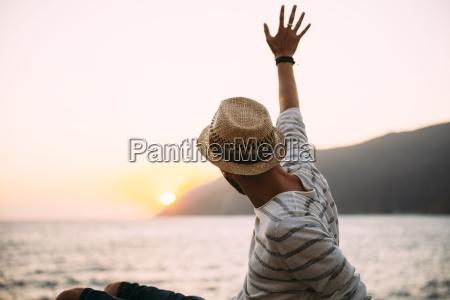greece cylcades islands amorgos man waving