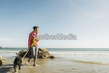 mature woman walking with dog at