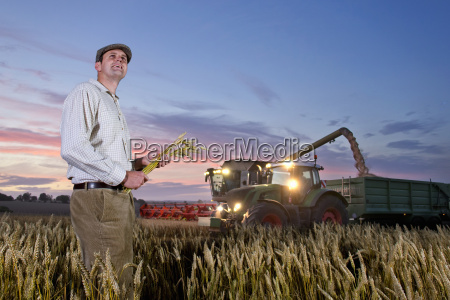 farmer standing in harvested wheat field