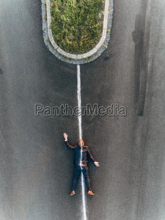 run over man lying on road