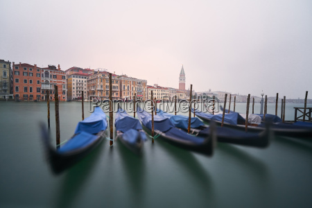 italy venice moored gondolas at twilight