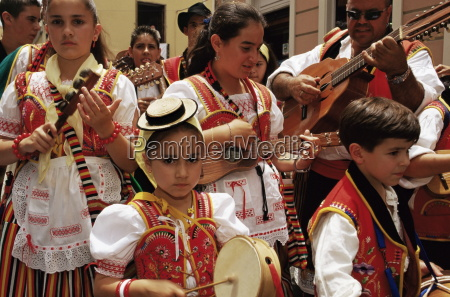 people wearing traditional dress and singing