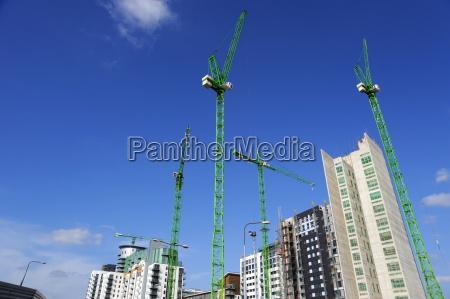 cranes on an apartment building site