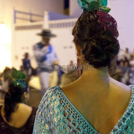 spanish girl watching horse back feria