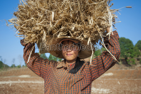 a girl carries a bundle of
