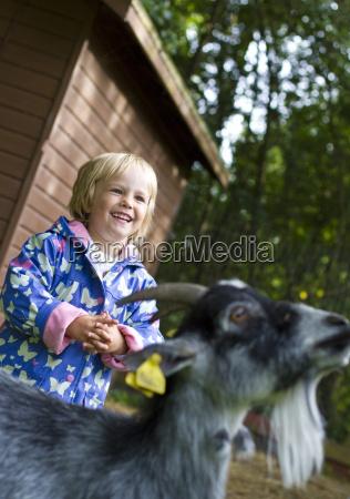denmark girl with goat smiling