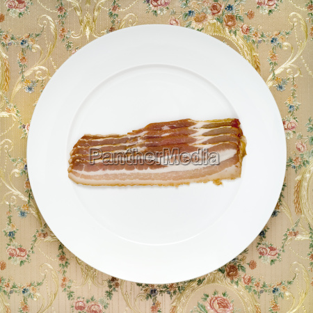 slices of bacon on plate elevated