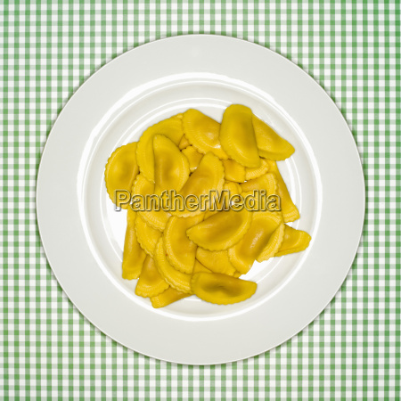 uncooked pasta on plate elevated view