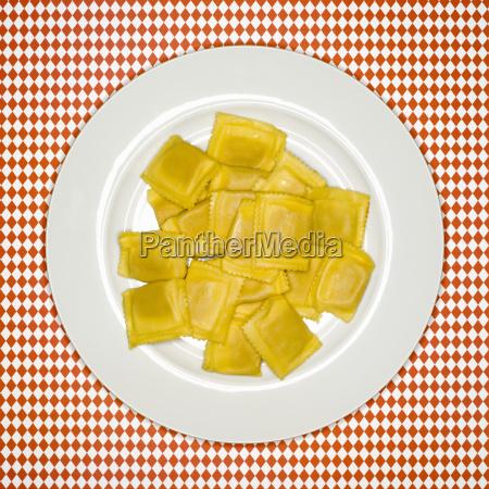 uncooked ravioli on plate elevated